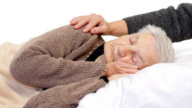Ill elderly woman lying in the bed
